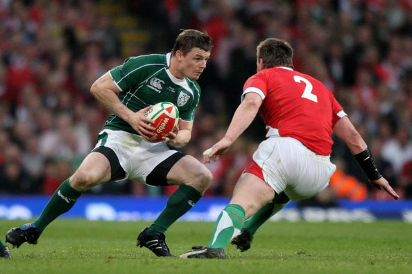 Ireland-Rugby-Captain-Brian-ODriscoll-takes-on-Matthew-Rees-of-Wales1